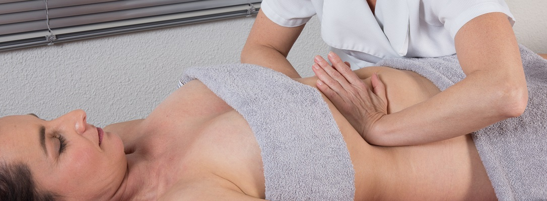 Position of hands and fingers at lymphatic drainage massage of a female body