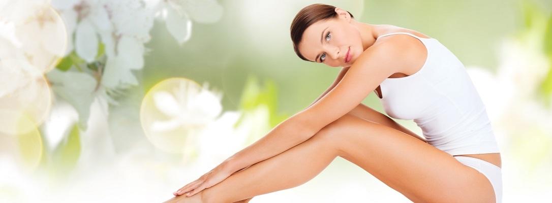 beautiful woman in cotton underwear touching legs