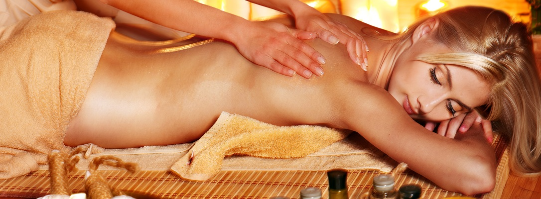 Woman getting herbal ball massage  .